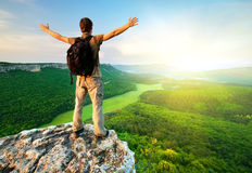 Man on top of mountain stock photography