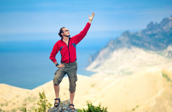 Man on top of mountain Stock Photos