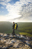 Man on top of mountain. Royalty Free Stock Photography