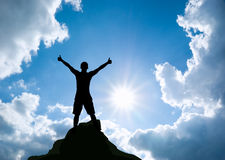 Man on top of mountain. Stock Image