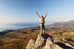 Man on the top of the mountain Stock Photo
