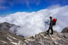 Man on top of mountain Royalty Free Stock Photos