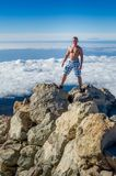 Man on top of the mountain Stock Images