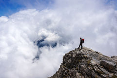 Man on top of mountain. Conceptual design Stock Image