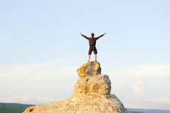 Man on top of mountain. Royalty Free Stock Image