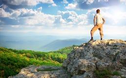 Man on top of mountain. Stock Photos