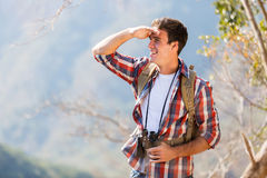 Man top mountain. Handsome young man on top of the mountain Stock Images