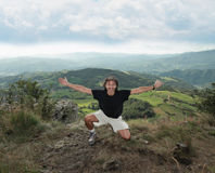 Man at the top of a mountain Royalty Free Stock Images