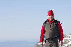 Man in the top of a in mountain hiking Stock Photos
