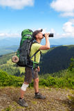 Man in top of mountain hiking drinking water. Hiker in the mountains drinking water from his water bottle. Drink and nature concept. Caucasian male hiker drink Royalty Free Stock Photo