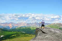 Man on top of the mountain looking at beautiful view. Royalty Free Stock Images