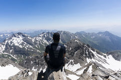 Man on top of mountain. Looking at the landscape Stock Photography