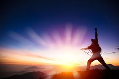 Man on the top of mountain. Watching sunrise Stock Photos