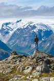 Man on top of mountain in Norway Stock Photo