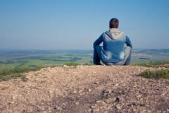 The man at top of the mountain rejoices to success. Winner. Royalty Free Stock Photography