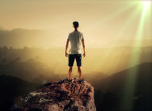Man on top mountain. Man stands on top mountain, close up Stock Image