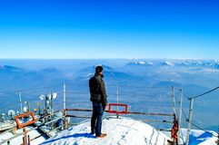 A man on top of mountain. A man stands on top of mountain, looks at view Royalty Free Stock Photography