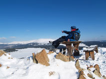 Man on top of a mountain. Man on a table on top of a mountain Stock Image