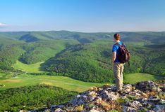 Man on top of mountain. Tourism concept Stock Image