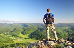 Man on top of mountain. Tourism concept Stock Images