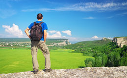Man on top of mountain. Tourist on the high rock Royalty Free Stock Photography