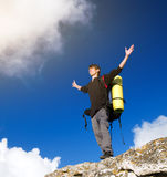 Man on top of mountain. Winner silhouette on the mountain top. Sport and active life concept Royalty Free Stock Image