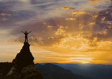 Man on the top of a rock Stock Photo