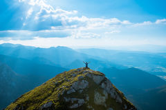 Man on the top of a rock stock photos