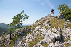 Man on the top of rock at trekking Royalty Free Stock Photography