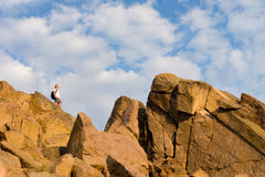 Man on top of a rocky mountain Stock Photography