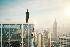 Man on the top of skyscraper looking at the city Stock Images