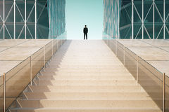 Man on the top of stairway between business centers outd. Businessman on the top of stairway between business centers outdoor Royalty Free Stock Photos