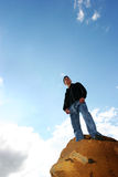 Man on top of the world royalty free stock photography