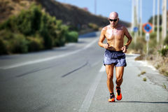 Man Topless Wearing Shades Jogging on Concrete Road during Daytime Stock Photo