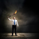 Man with torch Royalty Free Stock Photo