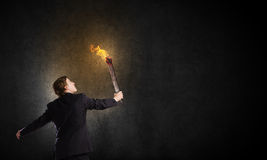 Man with torch Royalty Free Stock Photos