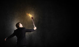 Man with torch Stock Photo