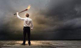 Man with torch Stock Image