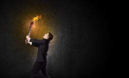 Man with torch Stock Images