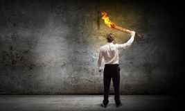 Man with torch Royalty Free Stock Image