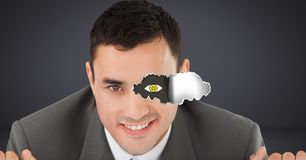 Man with torn paper on eye and eye drawing. Digital composite of Man with torn paper on eye and eye drawing Royalty Free Stock Photo