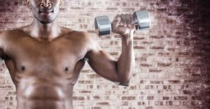 Man torso making fitness against a stone wall Royalty Free Stock Images