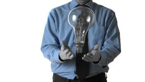 Man tossing a huge light bulb stock footage