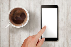 Man touch smart phone with isolated white screen for mockup. Royalty Free Stock Photo