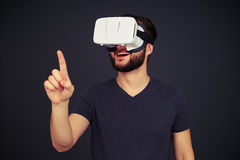 Man touch something using virtual reality glasses Stock Photos