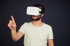 Man touch something wearing hi-tech VR headset Royalty Free Stock Photos