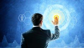 Man touch virtual screen. Glow elements Royalty Free Stock Photo