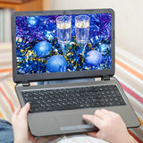 Man touches laptop with blue Xmas still life Royalty Free Stock Photography
