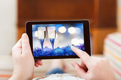 Man touches tablet-pc with blue Xmas still life Royalty Free Stock Image