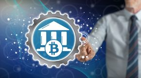 Free Man Touching A Bitcoin Regulation Concept Stock Photo - 159001120